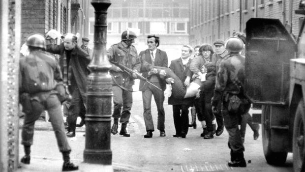 A victim is carried from the scene on Bloody Sunday