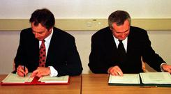 Tony Blair and Bertie Ahern sign the Good Friday Agreement