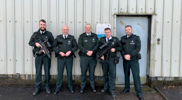Simon Byrne (centre) outside Crossmaglen PSNI station, a picture that he posted on Twitter