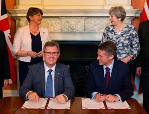 All smiles from Arlene Foster, Sir Jeffrey Donaldson, Theresa May and Tory chief whip Gavin Williamson after the DUP agreed to support the minority Government in 2017.