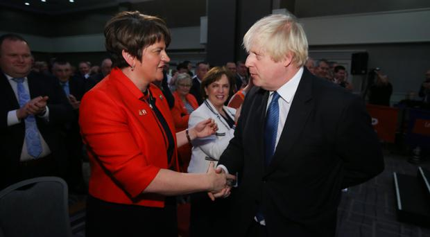 Arlene Foster with Boris Johnson at last year's DUP party conference