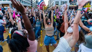 Hands up: People near the White House in Washington celebrate after Joe Biden's victory