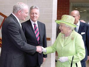 Queen Elizabeth II shaking hands with Northern Ireland Deputy First Minister Martin McGuinness
