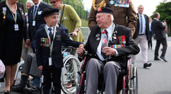 D-Day veteran John Quinn meets George Sayer in Bayeaux, France, on the 75th anniversary