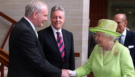 Historic gesture: The Queen greets Martin McGuinness on her visit to Ireland in 2012