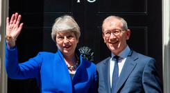 Painful exit: Theresa May leaving Downing Street with her husband, Philip