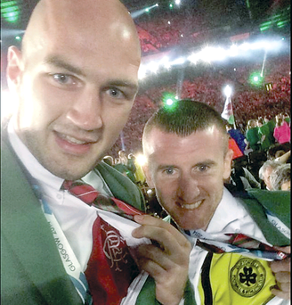 Cliftonville fan Paddy Barnes and Rangers devotee Steven Ward show their colours during the opening ceremony of the Games at Celtic Park