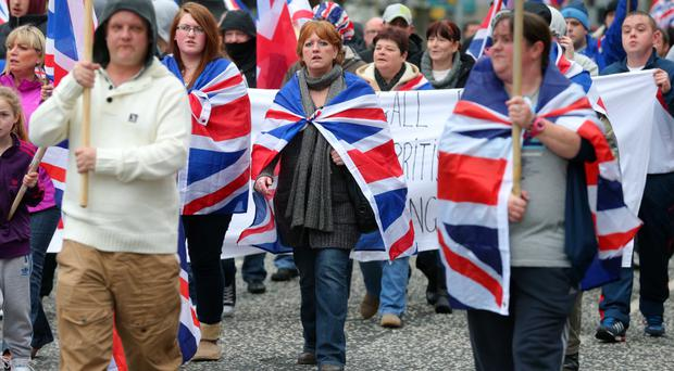Loyalist flag protesters on the march in Belfast