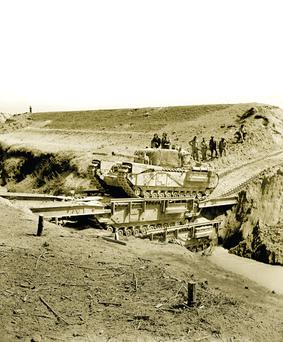 Bridging the gap: One of the tanks under the command of Richard McCreery crosses a ditch. He and Lucian King Truscott Jnr were instrumental in Operation Grapeshot, which culminated in the mass surrender of German forces in Italy