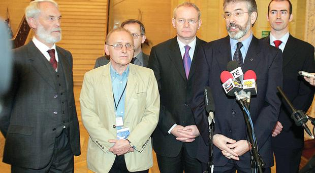 Gerry Adams speaks to the Press at Stormont on December 16, 2005 with Martin McGuinness beside him