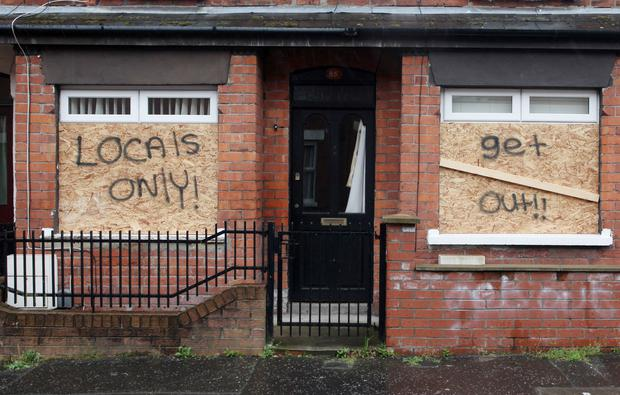 The rented homes of Polish families on Roslyn Street, east Belfast, daubed with graffiti
