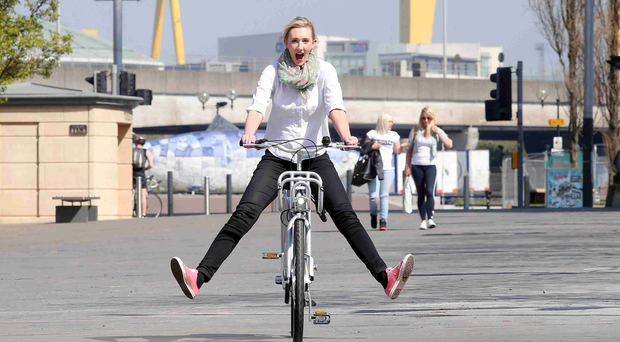 Journalist Sara Neill getting to ride the new City Bike system in Belfast