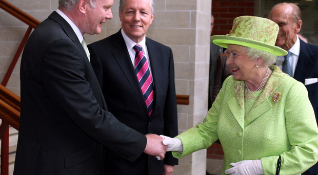 The Queen shakes hands with Deputy 2005 First Minister Martin McGuinness watched by First Minister Peter Robinson in 2012