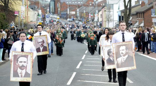 An Easter Rising parade makes its way to Milltown Cemetery