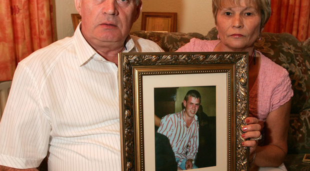 Stephen and Breege Quinn at their home in Cullyhanna, Co Armagh, with a picture of their son Paul