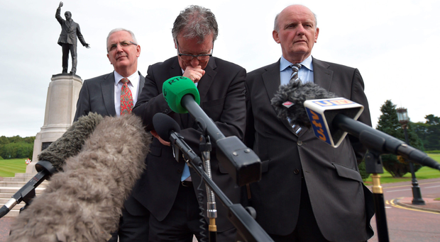Ulster Unionist Party leader Mike Nesbitt holds a press conference with fellow party members at Stormont
