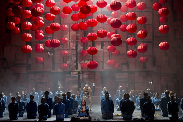 Cardboard boxes and workers' blue overalls give a contemporary twist to the version of Turandot at the Grand Opera House