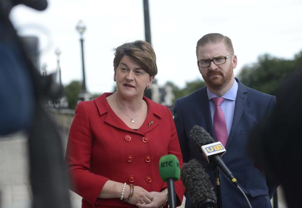 The DUP's Arlene Foster and Simon Hamilton speak to the media following the announcement of the three panel members who will oversee an independent assessment of paramilitary organisations