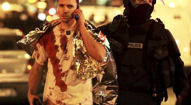 Night of terror: a blood drenched man in Paris after Friday's attacks