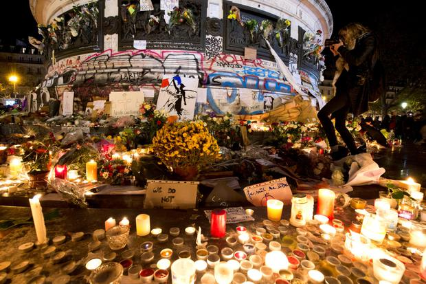 A candle-lit memorial at the Place de la République to the victims of the terrorist attacks on Friday