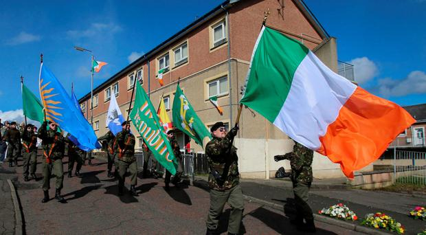 A colour party from the 32 County Sovereignty Movement parades to Creggan Cemetery