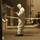 A forensic officer at scene of Michael's killing