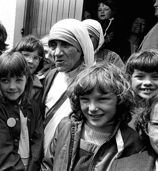 Mother Teresa of Calcutta with local children during a visit to the cross-community Corrymeela Centre in Ballycastle in 1981
