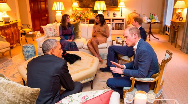 The Duke of Cambridge talks to the President of the United States Barack Obama (front left), with the Duchess of Cambridge, First Lady Michelle Obama (back left) and Prince Harry (back right). Photo: Dominic Lipinski/PA Wire