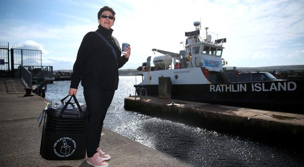 Senior presiding officer and polling station manager Teresa McCurdy with a ballot box on Rathlin