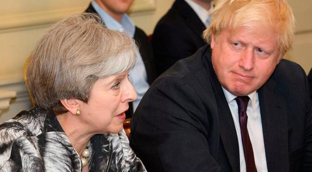 Theresa May could be facing a Tory leadership challenge from Boris Johnson (right)