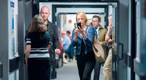 BBC Political Editor Laura Kuenssberg accompanied by one of her bodyguards at the Labour Party conference