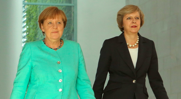 Troubled times: Angela Merkel and Theresa May