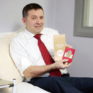 Ulster Unionist leader Robin Swann receives recognition after giving blood for the 50th time