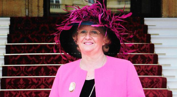 Margaret McGimpsey at Buckingham Palace with her MBE