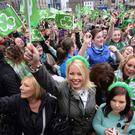 Annual parades: people wave flags during a previous St Patrick's Day celebration