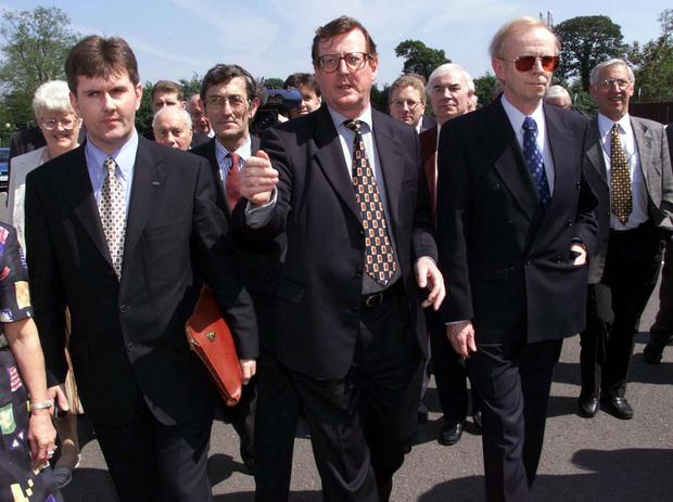 Ulster Unionist leader David Trimble (centre) leads Jeffrey Donaldson and Reg Empey into talks with the British and Irish Governments at Stormont in June 1999