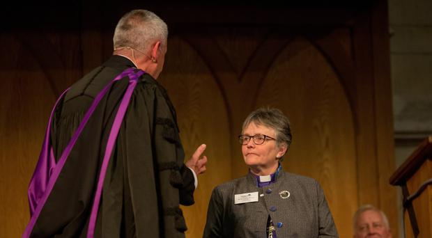Great divide: Dr Charles McMullen, the new Moderator, welcomes Rev Susan Brown Moderator of the Presbyterian Church in Scotland, to the General Assembly