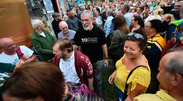 Gerry Adams attends a rally on Monday called in support of the former Sinn Fein president after the attack on his home