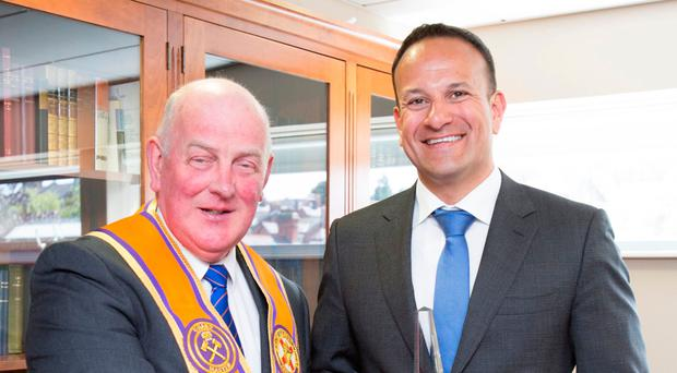 Mixed messages: Taoiseach Leo Varadkar is welcomed to the Orange Order headquarters by Edward Stevenson but the institution declined to engage with Sinn Fein leader Mary Lou McDonald