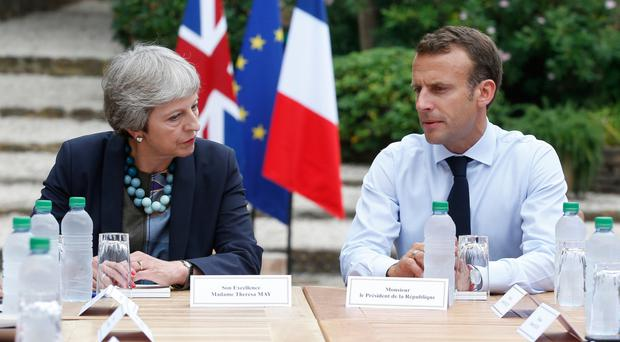 Theresa May and French President Emmanuel Macron discuss the issue of Brexit at the Fort de Bregancon in Bornes-les-Mimosas in southern France last week