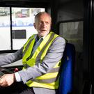 Jeremy Corbyn sits behind the wheel of a bus as he campaigns on his party's 'Build it in Britain' policy