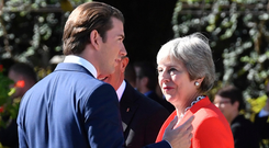 Austrian chancellor Sebastian Kurz talks to Theresa May at the Salzburg summit