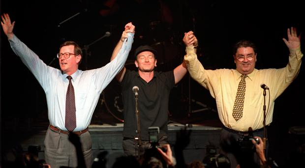David Trimble, John Hume and U2's Bono on stage at the Waterfront Hall in Belfast to promote a 'Yes' vote in 1998