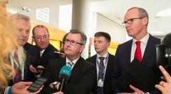 Jeffrey Donaldson (centre) alongside Simon Coveney (right) at the FG conference last we