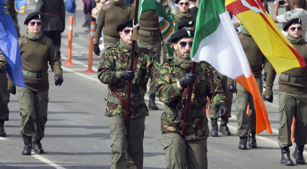 The colour party marches along O'Connell Street during the Saoradh Easter Commemoration in Dublin