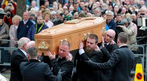 Lyra McKee's coffin is carried into St Anne's Cathedral yesterday