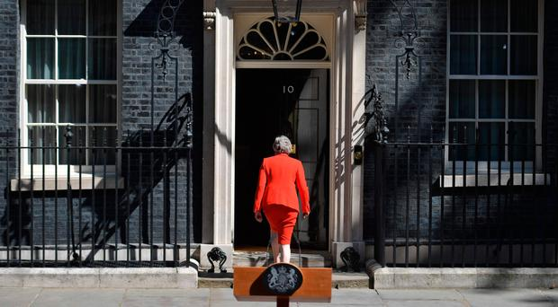 Theresa May returns to 10 Downing Street after announcing her resignation as Prime Minister