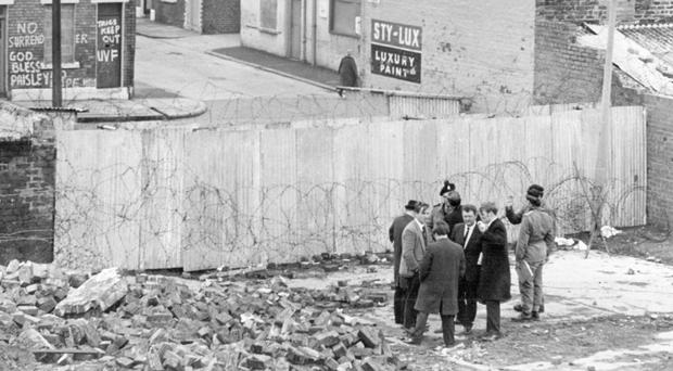 An inspection of the new peace line in the Bombay/Cupar Street area of Belfast in 1970