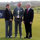 Arlene Foster and Martin McGuinness at a photocall at Royal Portrush in October 2015 with Darren Clarke