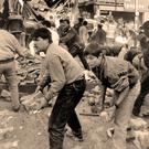 People clear away rubble after the Shankill bomb in October 1993